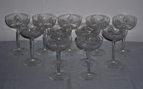19: Eleven colorless cut crystal champagne saucers