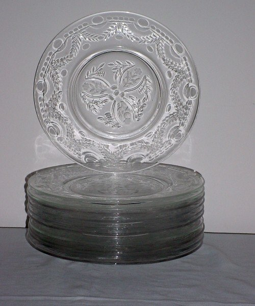 21: Eleven colorless etched crystal plates