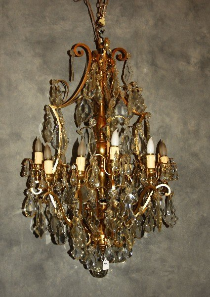 "Large bronze and crystal 16-light chandelier. H: 44"" D:"