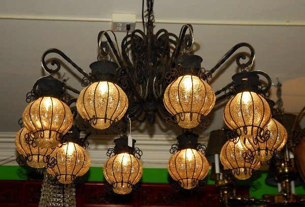 Iron 10-light chandelier with crackle glass globes. H: