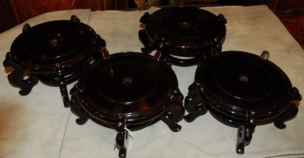 "Four Chinese lacquer wood stands. H: 6"" D: 12"""