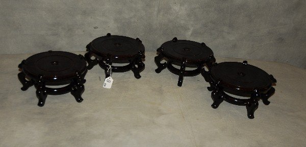 "Four Chinese lacquer wood stands. H: 4 5"" D: 9"""