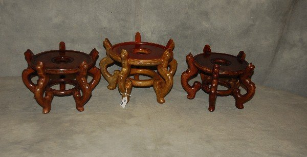 "Three Chinese wood stands. Largest: 9"" x 14"" Smallest:"
