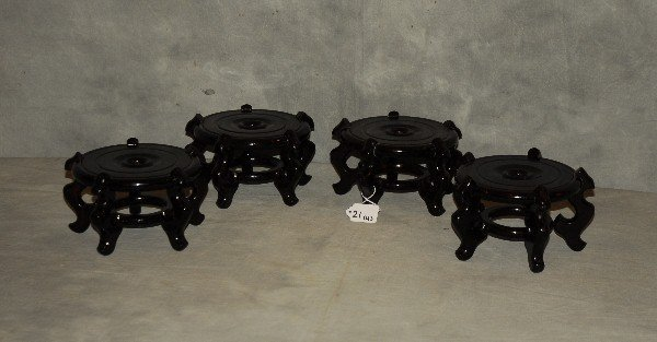 "Four Chinese lacquer wood stands. H: 4 5"" D: 8"""