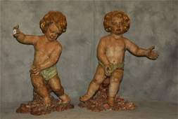True pair of 18th c. Italian carved wood and polychrome