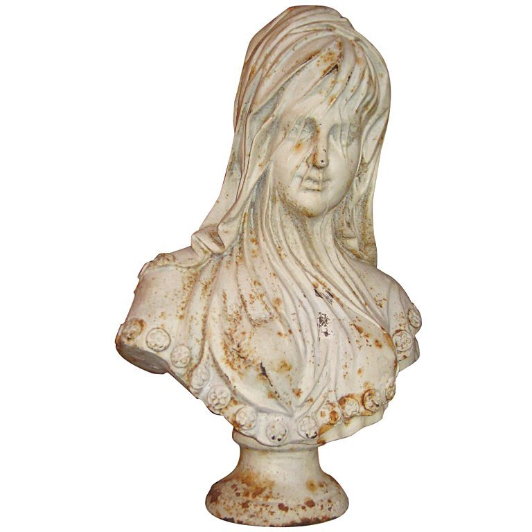 "19th c. cast iron bust of a Veiled Woman. H: 26"" W: 18"""