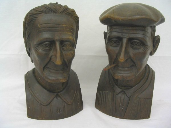 L519-Pair of wooden carvings, European lady and man.