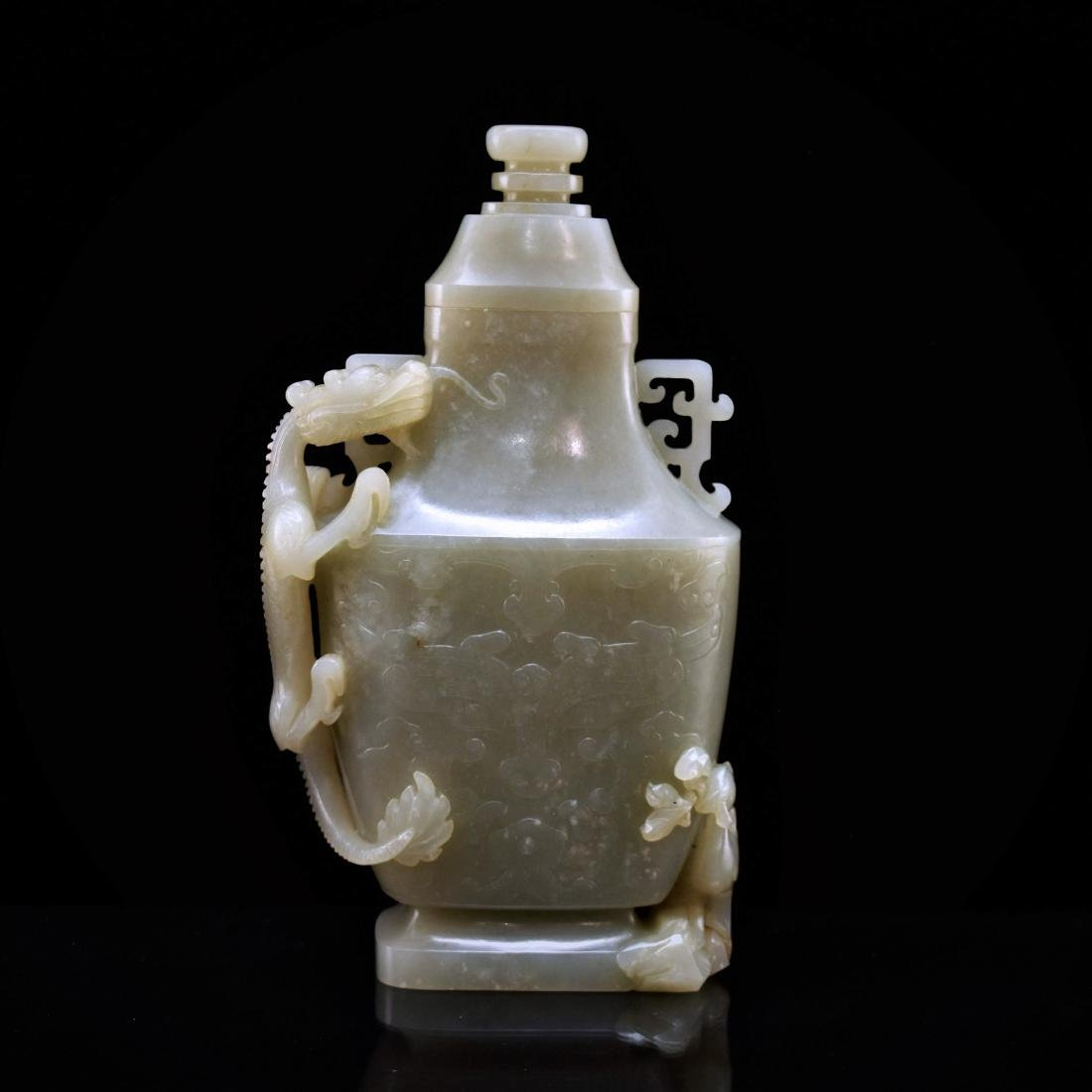 DRAGON AND FLORAL COVERED JADE VASE