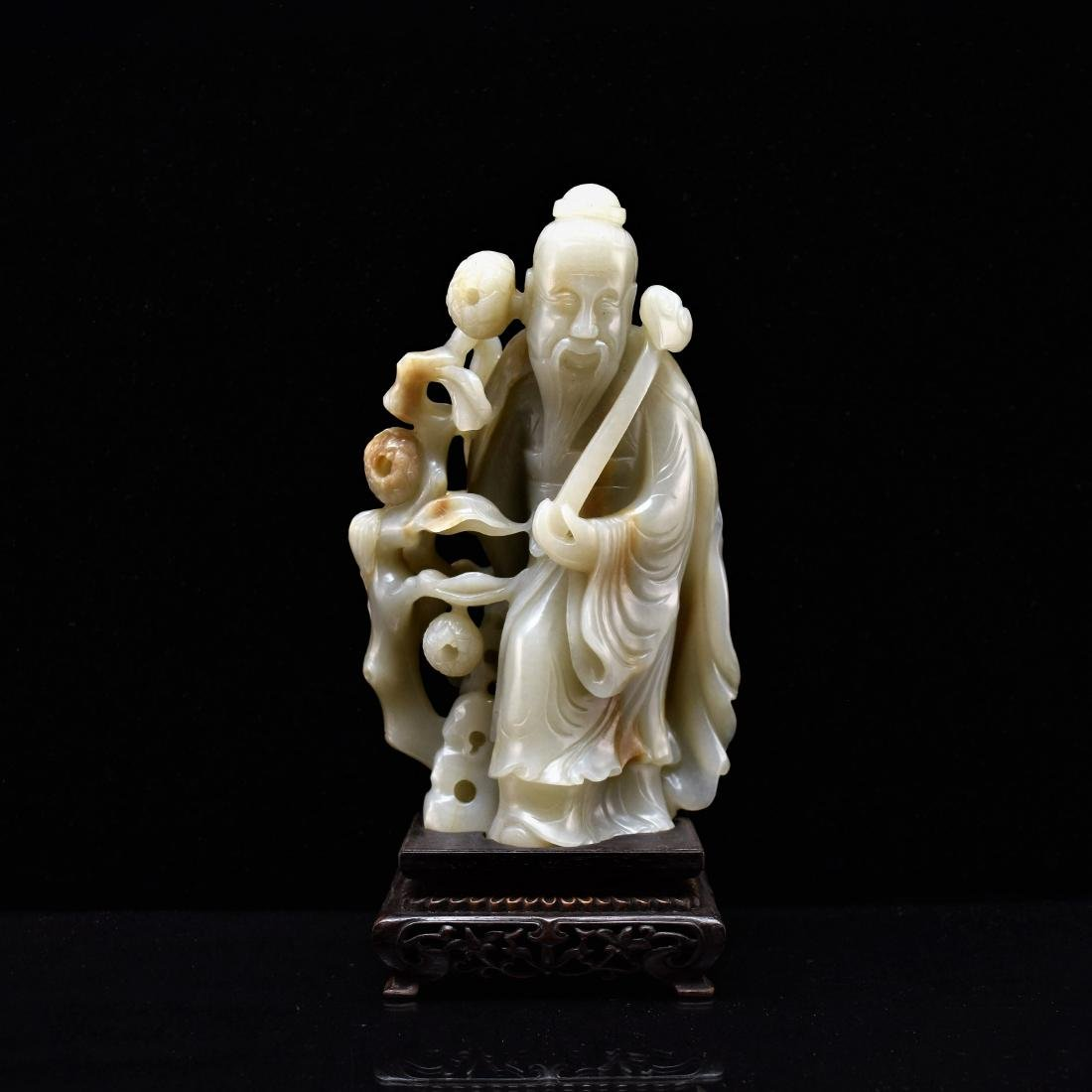 FINE CARVED CHINESE JADE OF SHUOLAO ON STAND