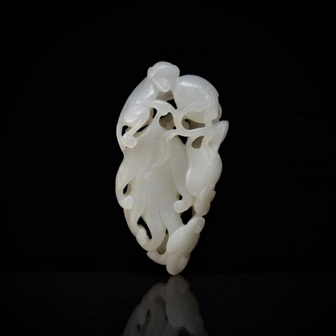 CARVED WHITE JADE OF MONKEY ON BUDDHA PALM CITROEN