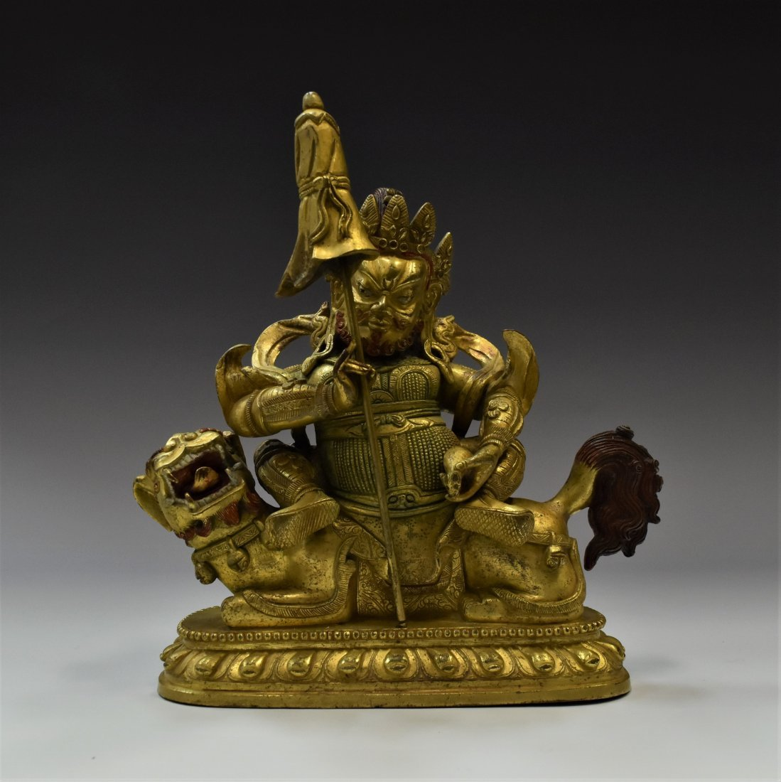 RIDING LION VAISHRAVANA GILT BRONZE BUDDHA STATUE