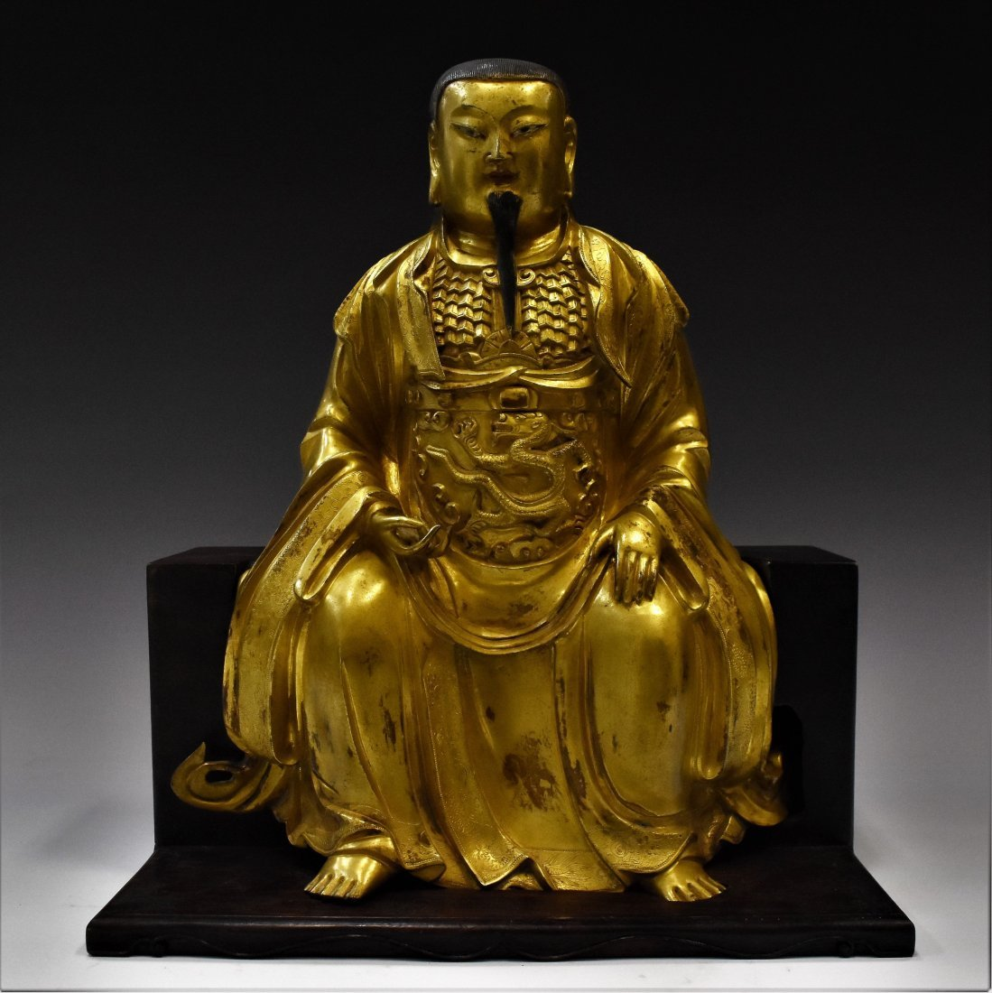 MING SEATTED BUDDHA ON SOLID WOODEN STAND