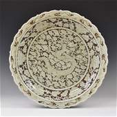 EARLY MING REVERSED GRAYISH-RED DRAGON CHARGER