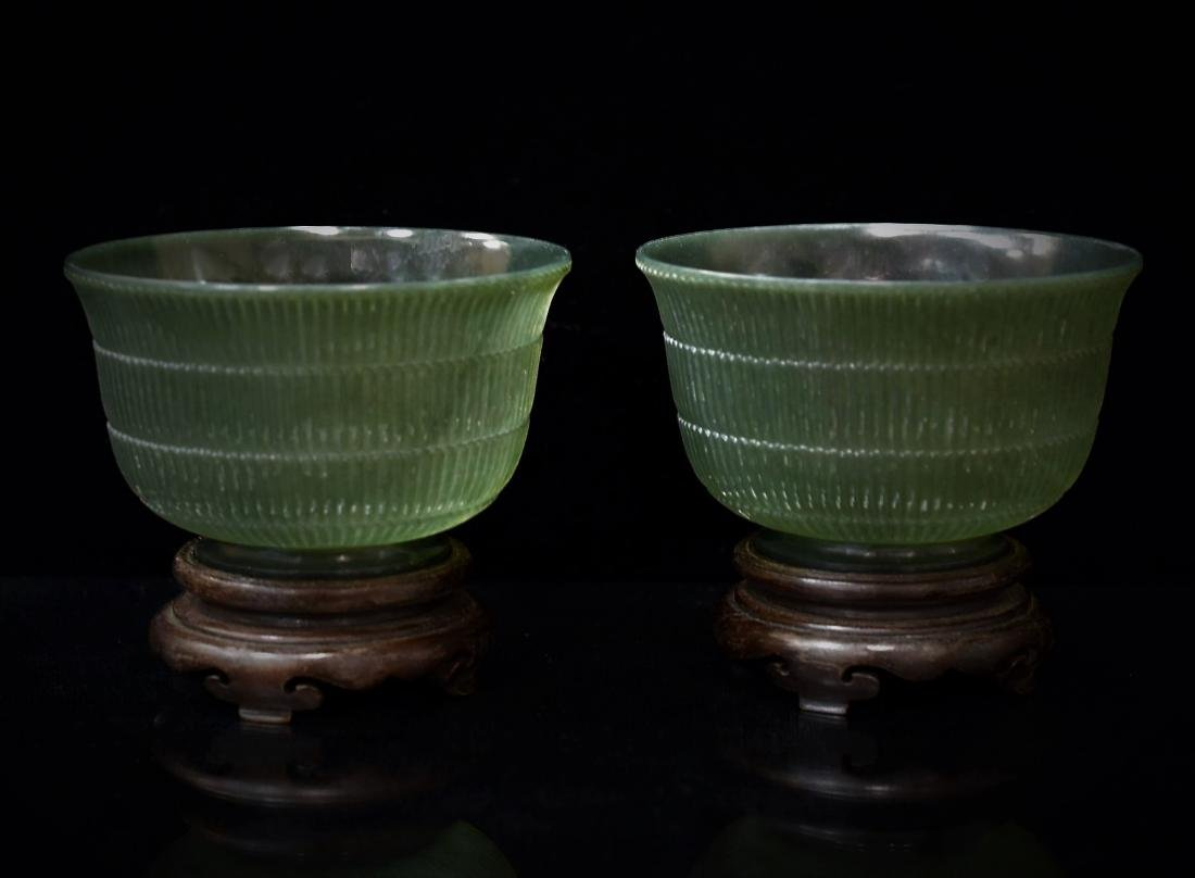 PAIR OF CARVED SPINACH-GREEN JADE BOWLS