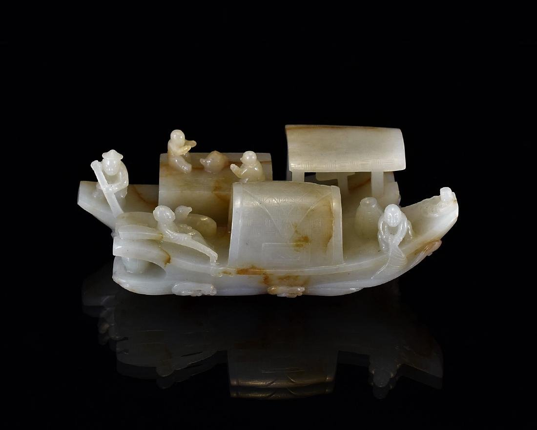 A CARVED CHINESE JADE RECUMBENT DOUBLE BOATS