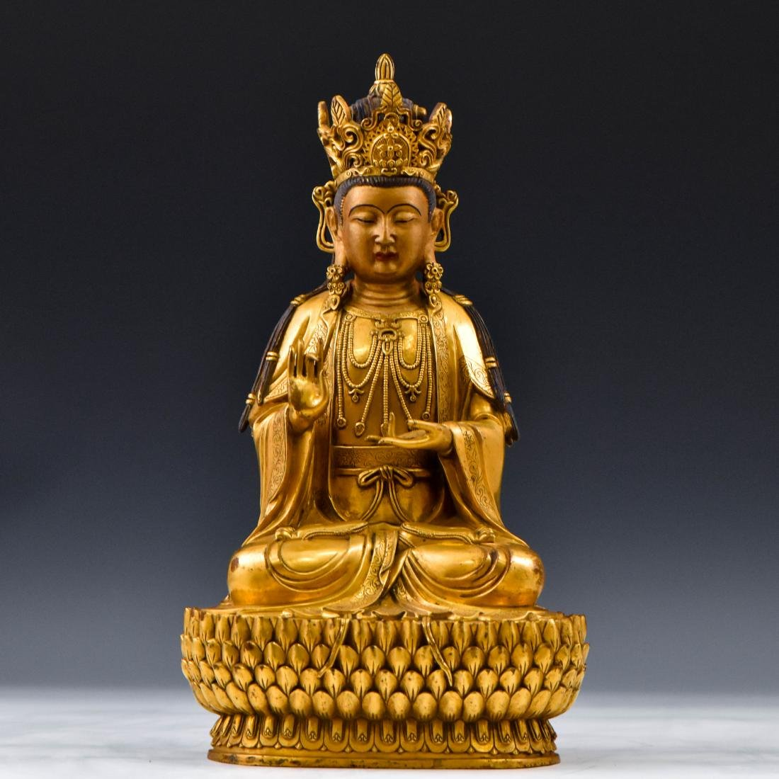 LARGE MING GILT BRONZE SEATED BUDDHA