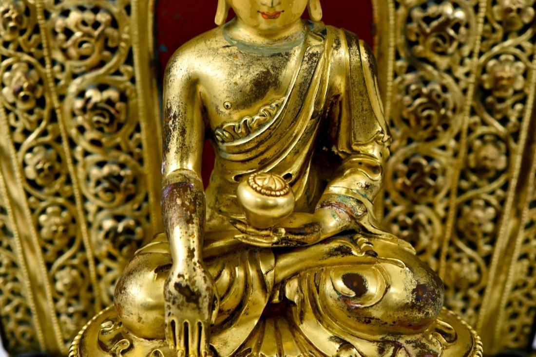 MING YONGLE GILT BRONZE BUDDHA WITH AUREOLA - 11