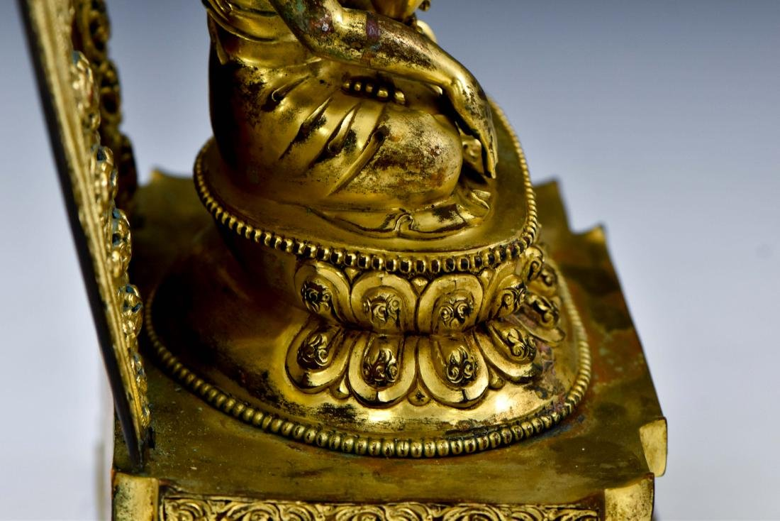 MING YONGLE GILT BRONZE BUDDHA WITH AUREOLA - 14