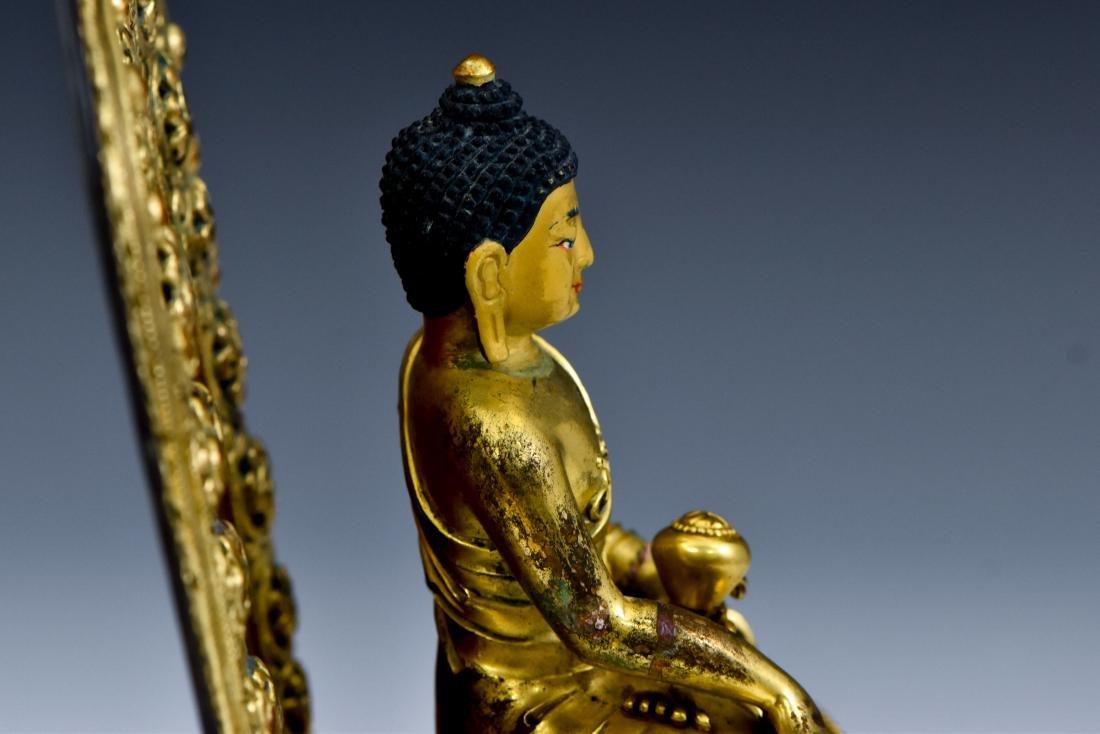 MING YONGLE GILT BRONZE BUDDHA WITH AUREOLA - 15