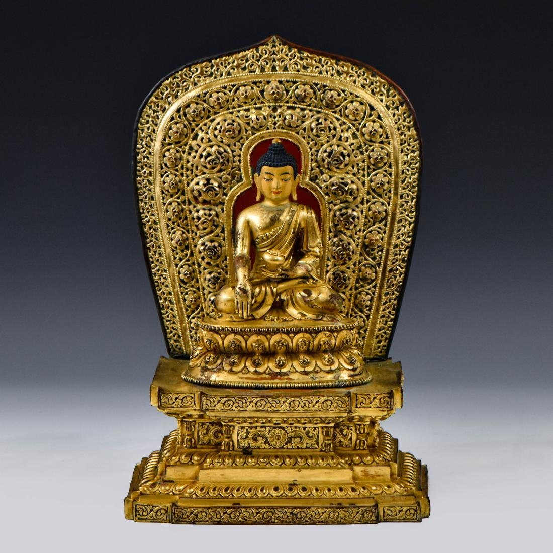 MING YONGLE GILT BRONZE BUDDHA WITH AUREOLA