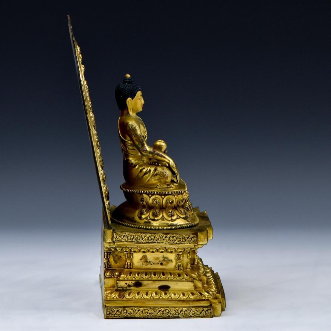 MING YONGLE GILT BRONZE BUDDHA WITH AUREOLA - 2