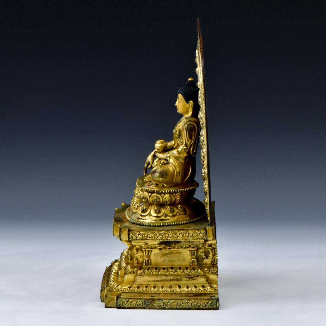 MING YONGLE GILT BRONZE BUDDHA WITH AUREOLA - 3