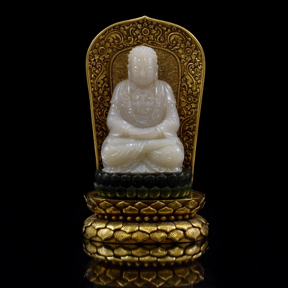 GREEN & WHITE JADE BUDDHA ON GILT BRONZE AURA THRONE