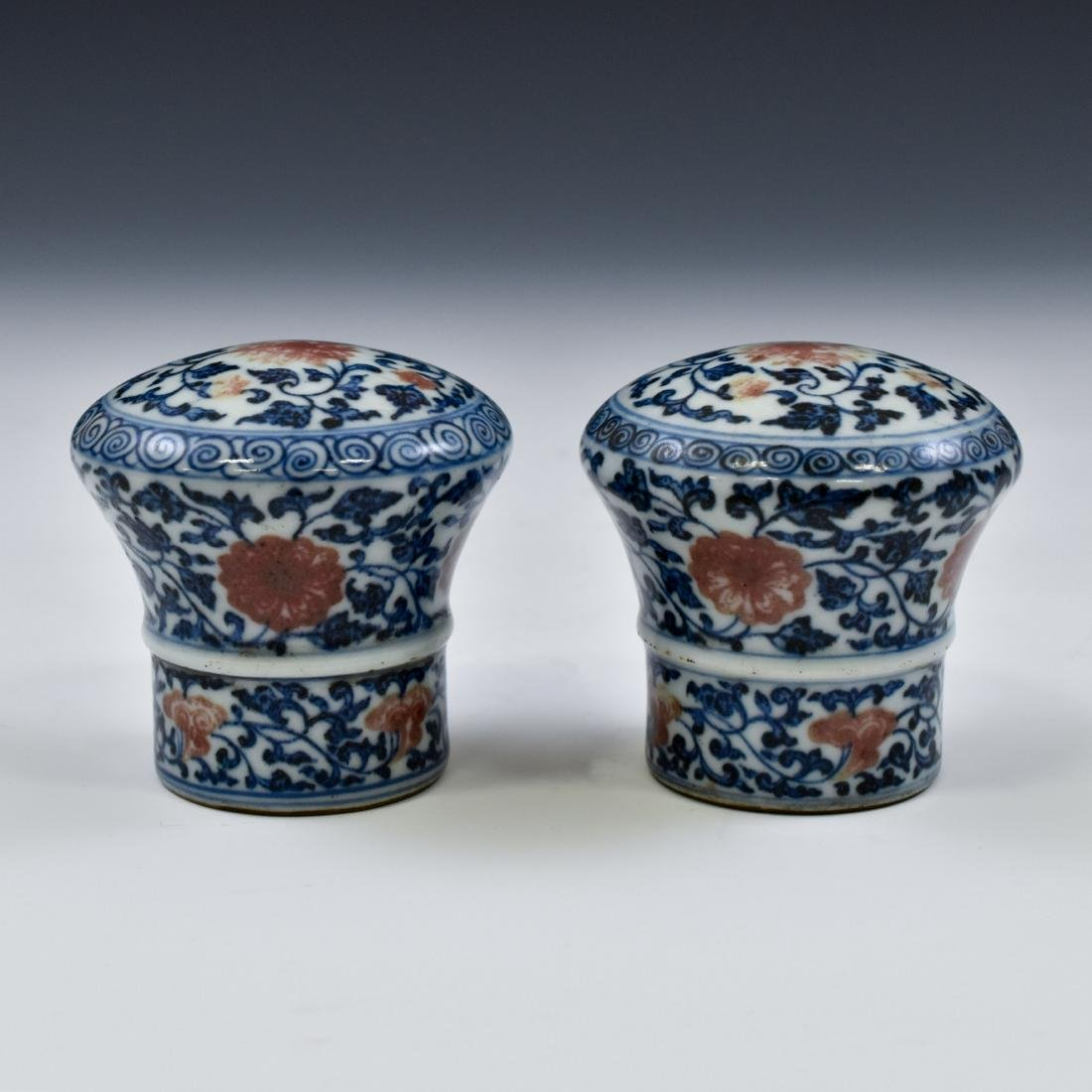 17TH C PAIR OF PORCELAIN SCROLL KNOBS IN FLORAL MOTIF