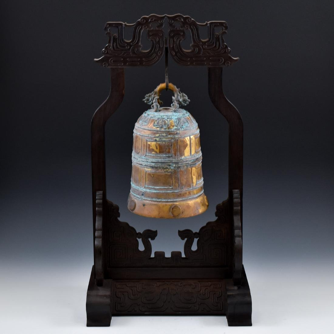 CHINESE GILT-BRONZE RITUAL BELL ON STAND