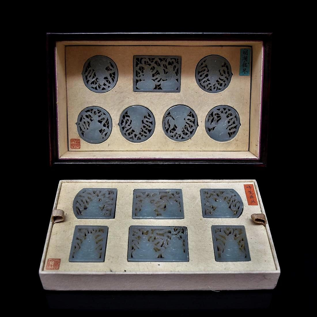 SET OF 13 CARVED JADE MEDALIONS AND PLAQUES IN A BOX