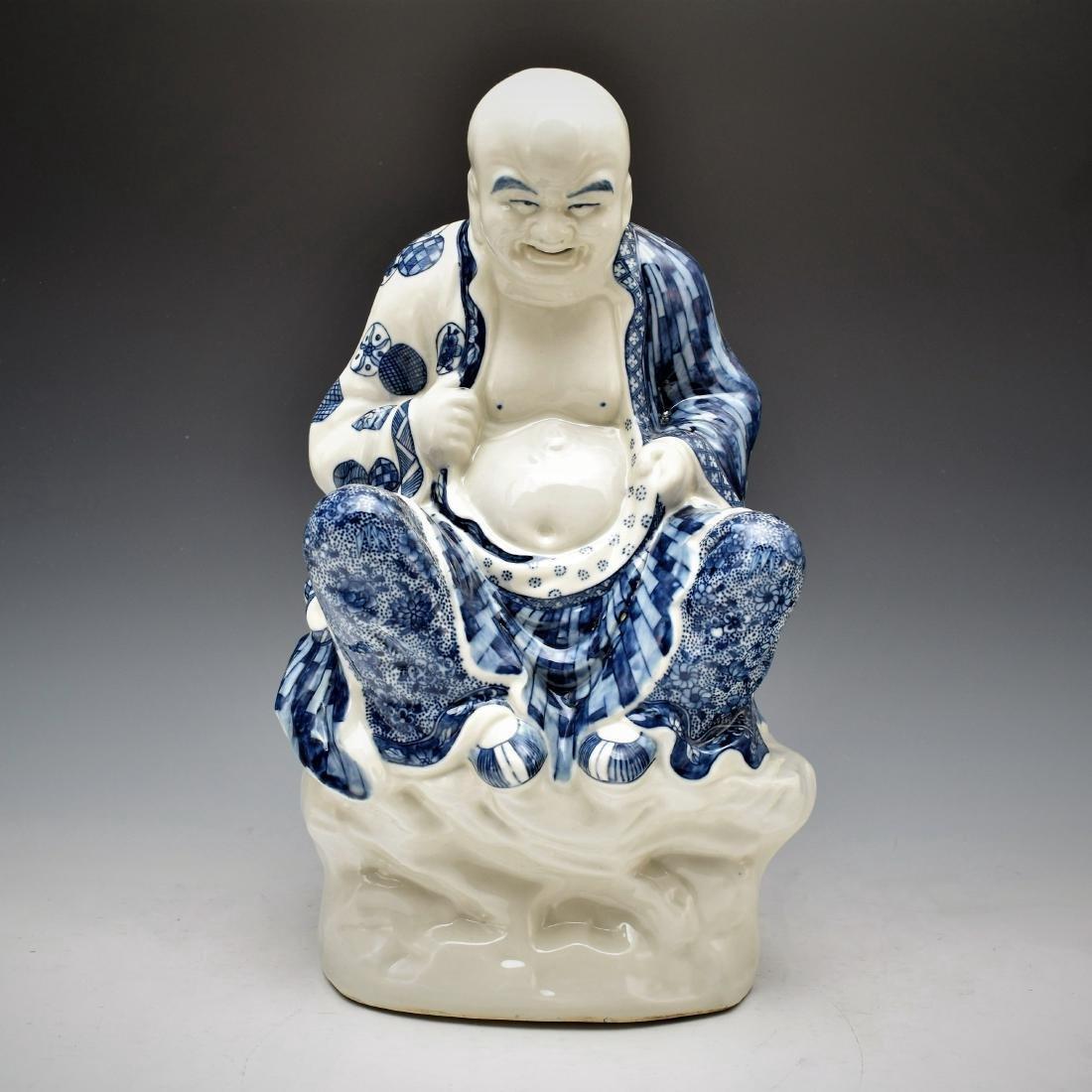 BLUE UNDERGLAZED PORCELAIN SEATED BUDDHA