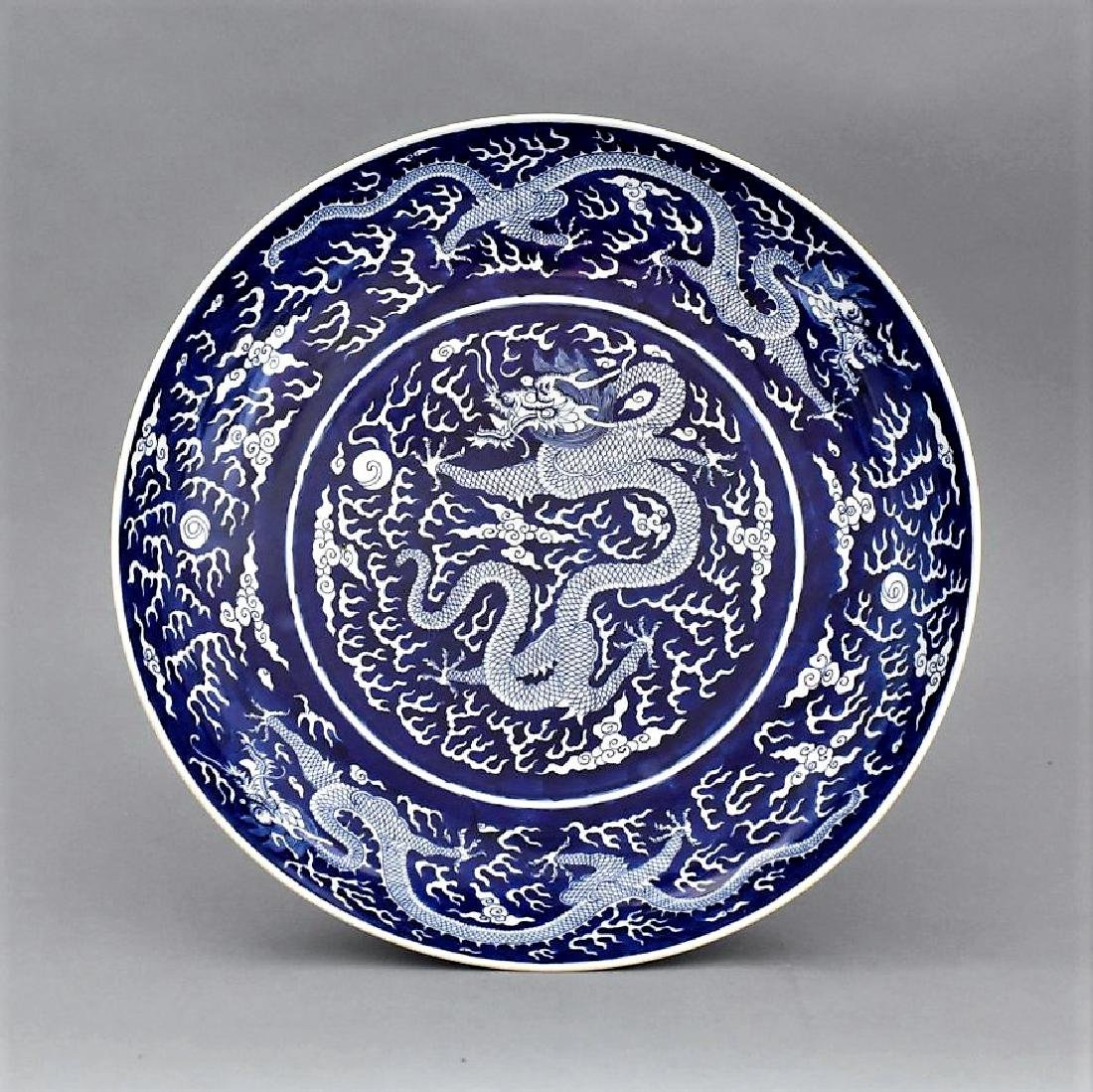 DAOGUANG REVERSED BLUE GLAZED DRAGON CHARGER