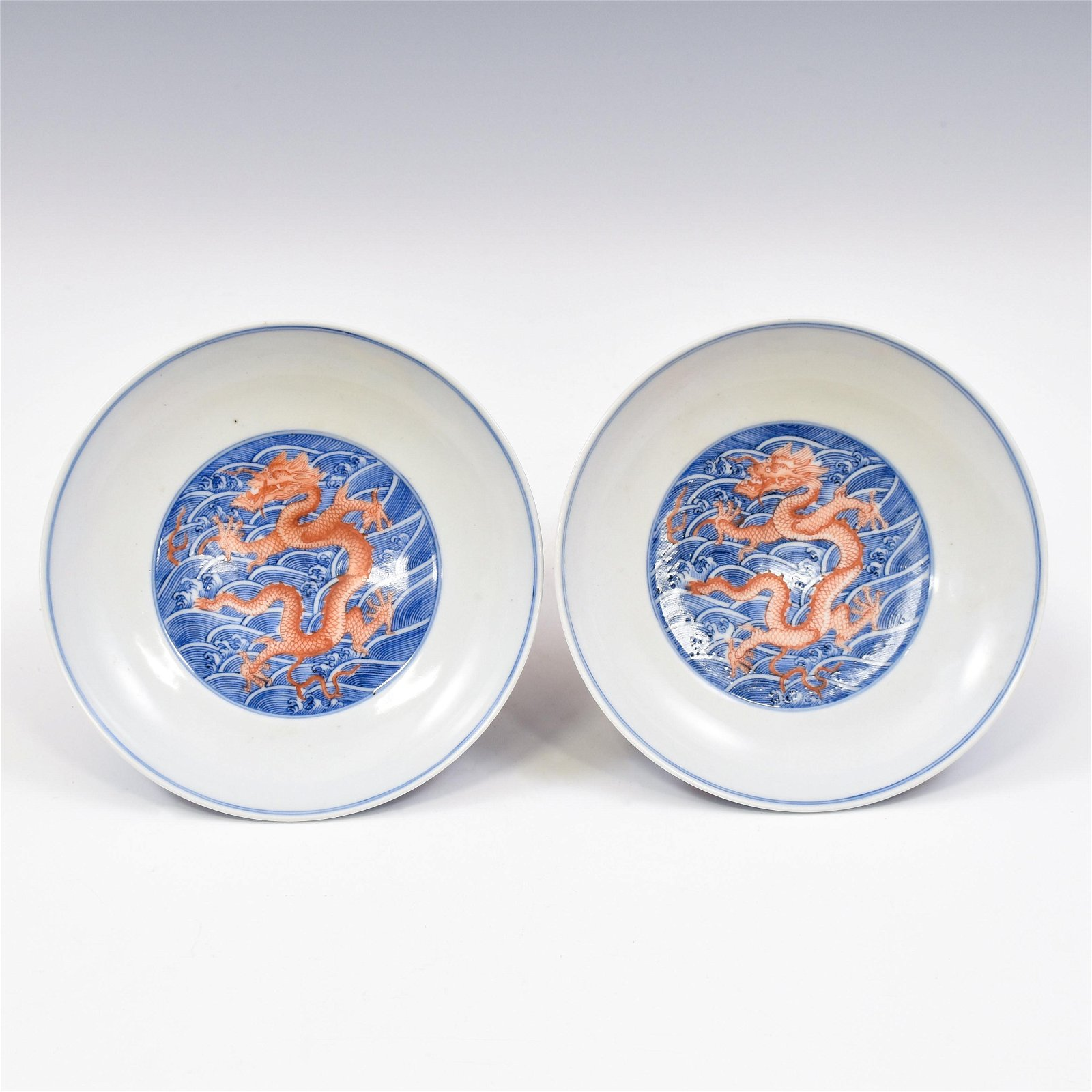 PAIR OF YONGZHENG BLUE AND RED DRAGON PLATES