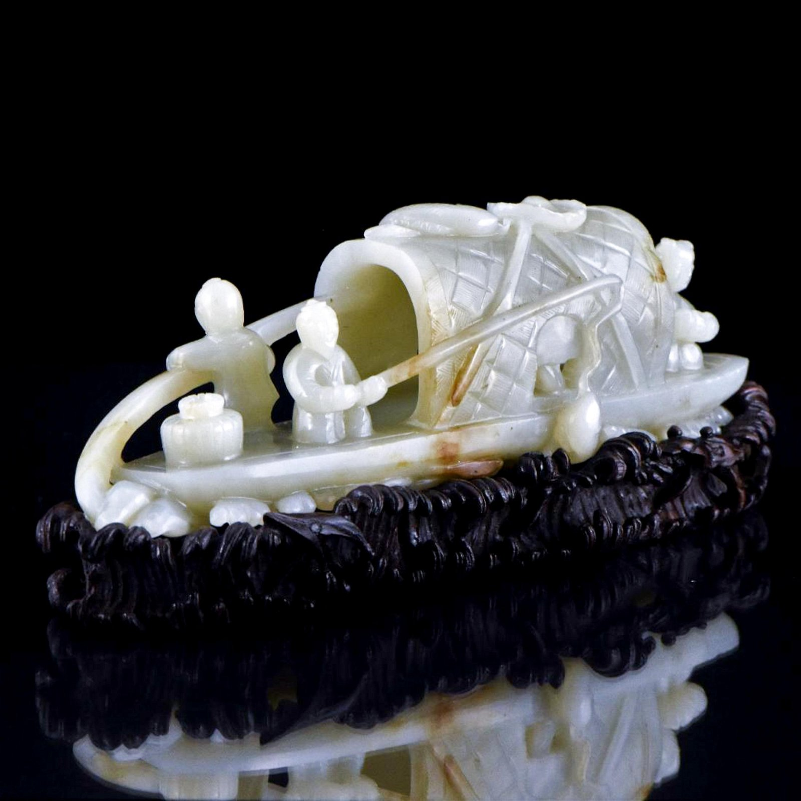CARVED CHINESE JADE MODEL OF FIGURES ON BOAT
