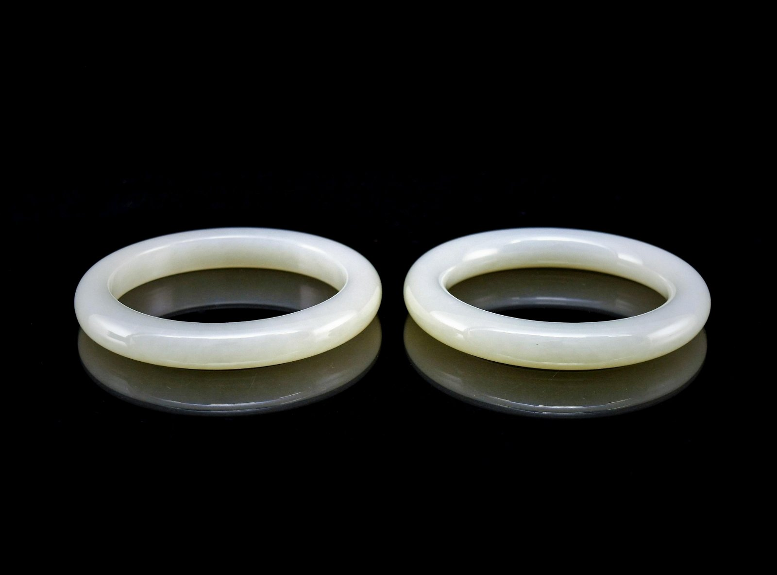 PAIR OF CARVED WHITE JADE ROUND BANGLE