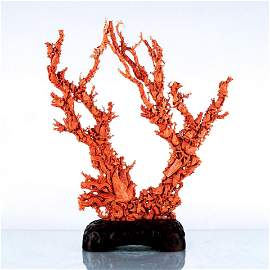 LARGE CARVED RED CORAL GROUP WITH AVIAN MOTIFS
