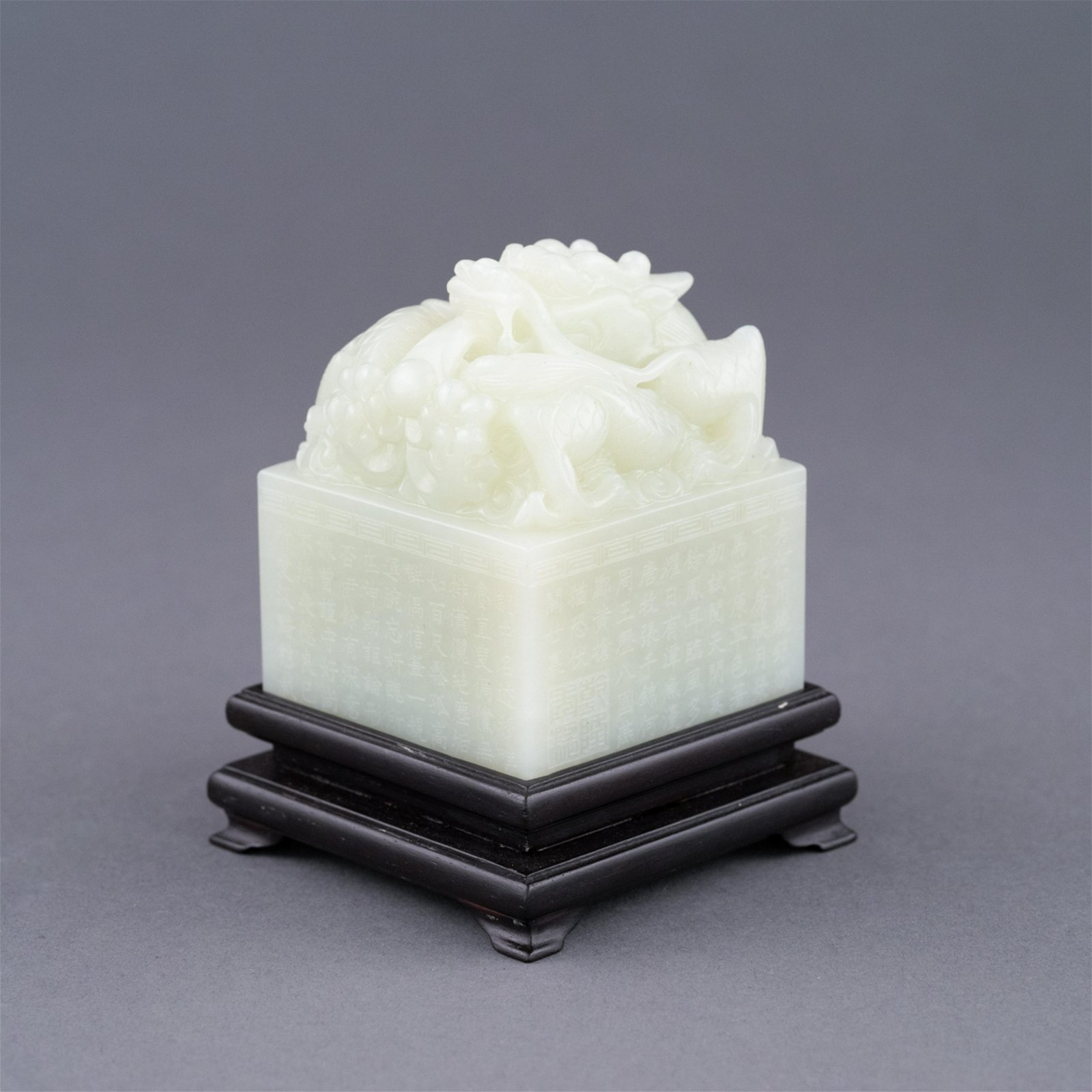WHITE JADE CARVED DRAGON SEAL ON STAND