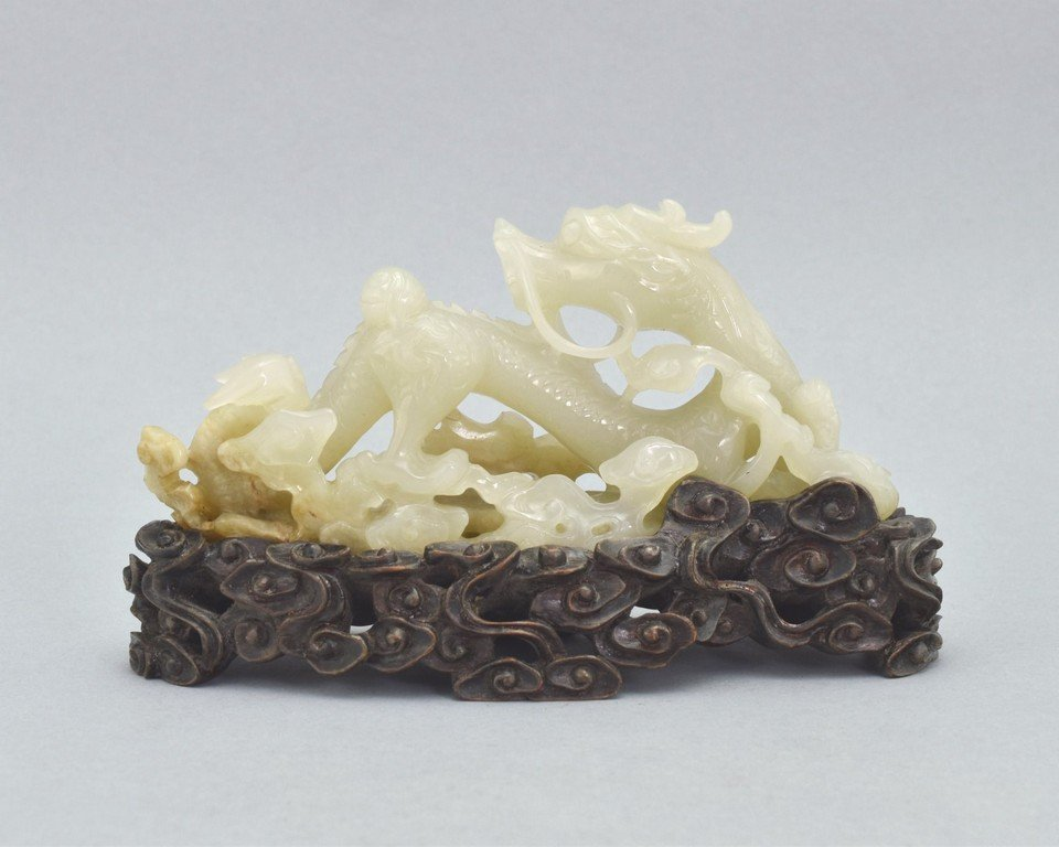 CARVED JADE OF DRAGON AMIDST CLOUDS ON STAND