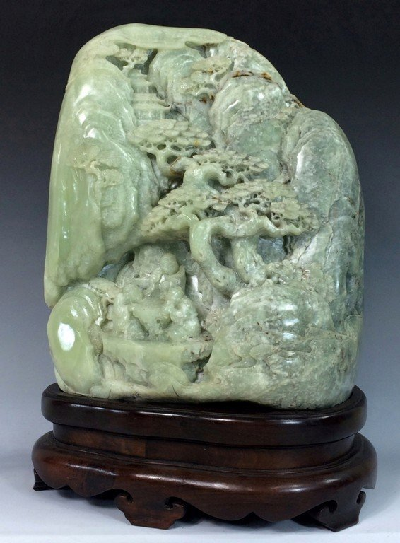 A MASSIVE PALE CELADON AND RUSSET JADE MOUNTAIN