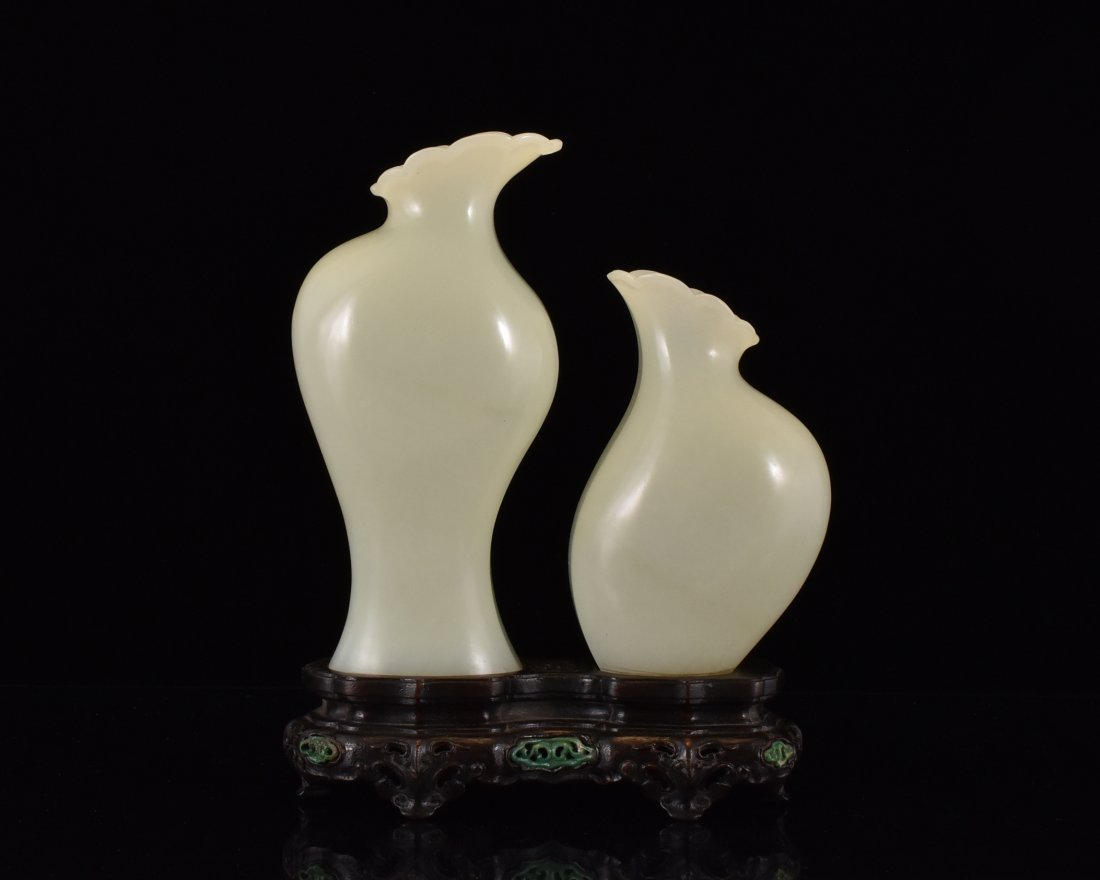 PAIR OF FLORI-FORM JADE VASES ON STAND