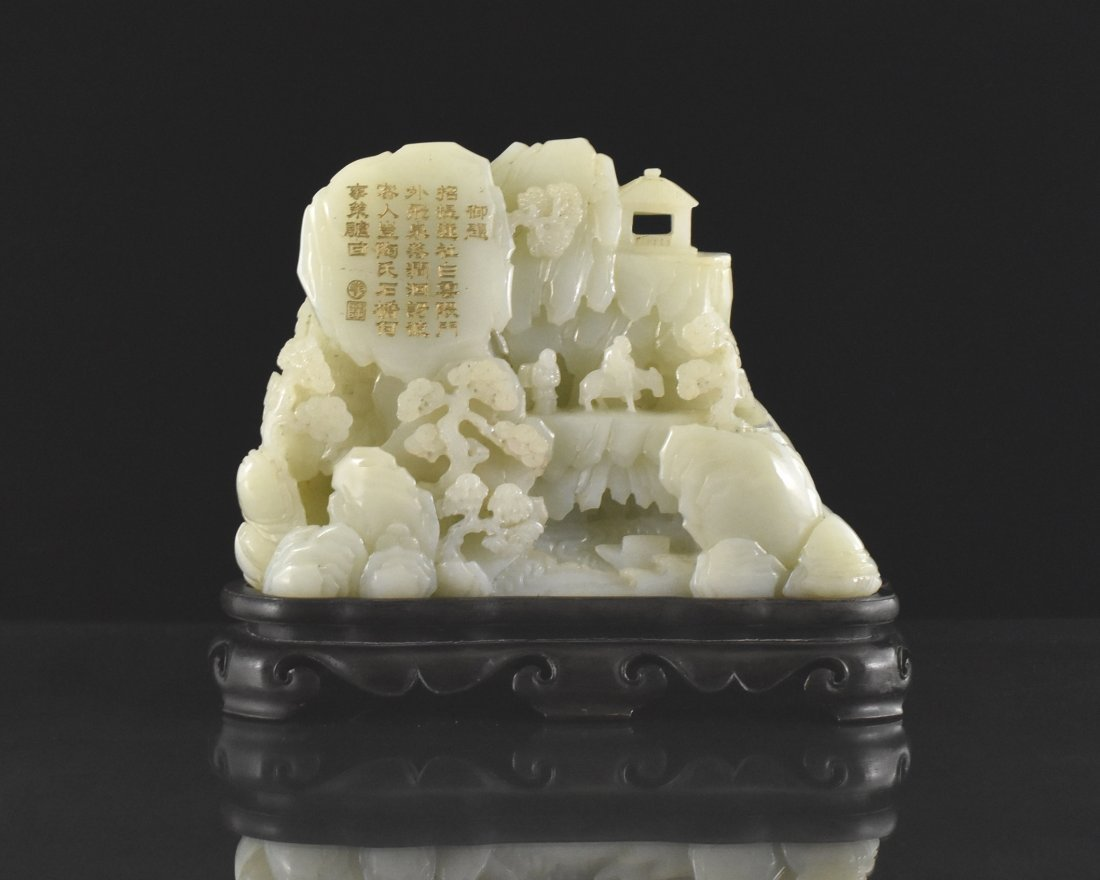 A LARGE CARVED WHITE JADE MOUNTAIN
