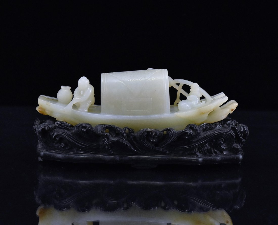 A CARVED CHINESE JADE MODEL OF FIGURES ON BOAT