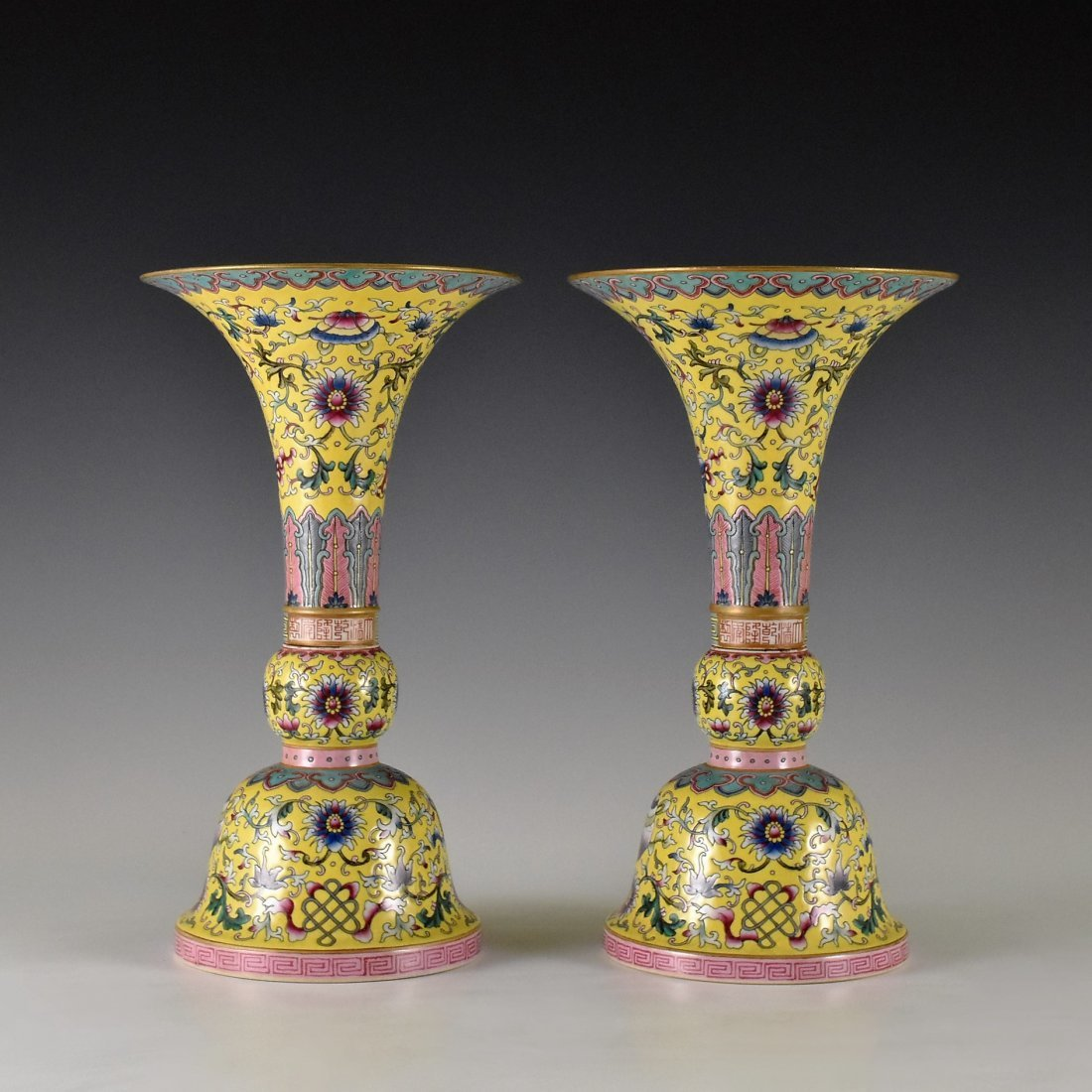 PAIR OF FAMILLE ROSE GU VASES ON YELLOW GROUND