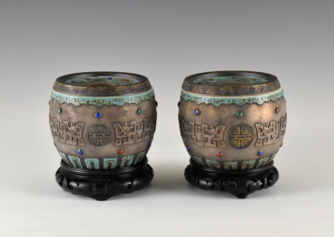 PAIR OF CARVED GILT PORCELAIN LIDDED JARS ON STAND