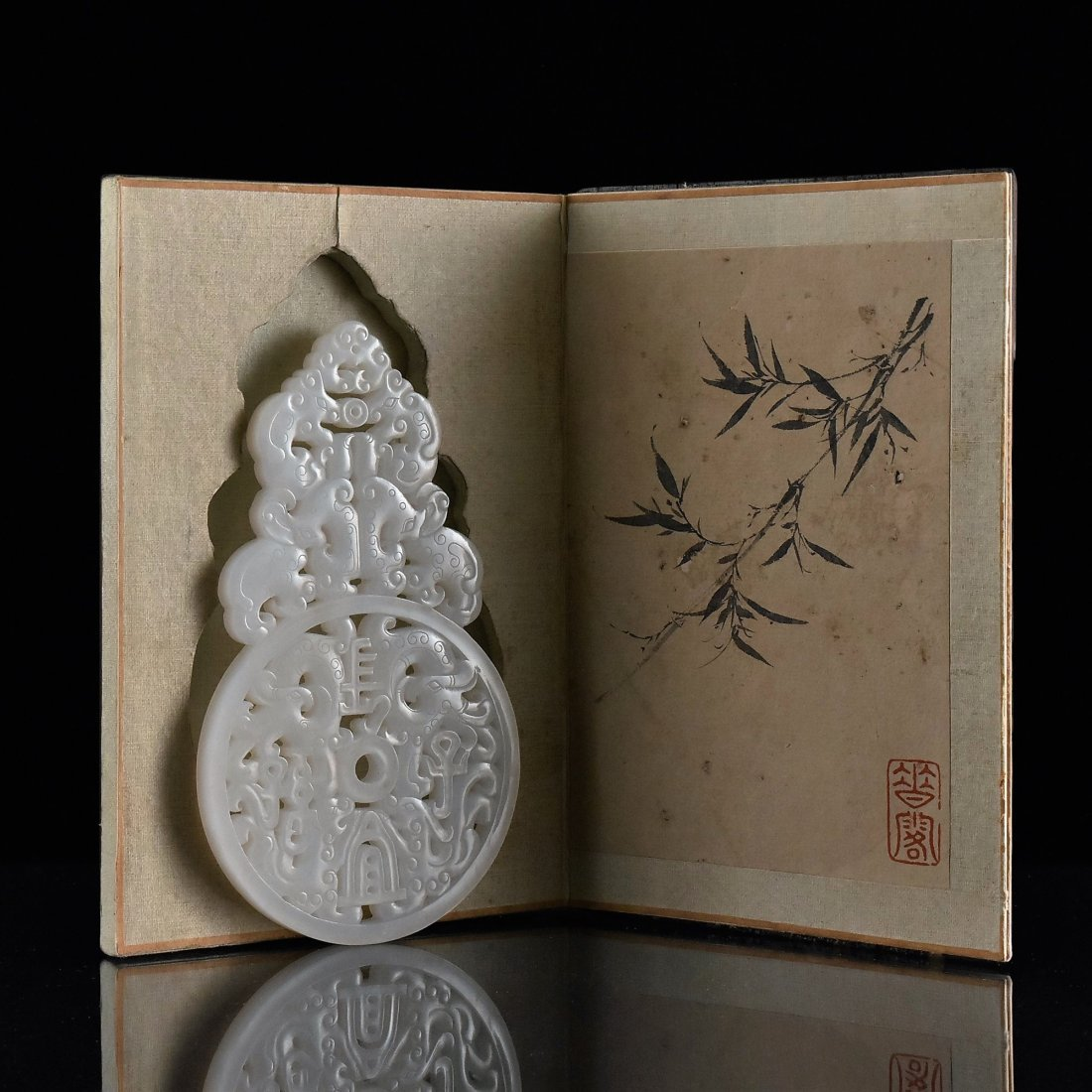 PIERCED WHITE JADE IN BOOK SHAPED WOODEN  BOX