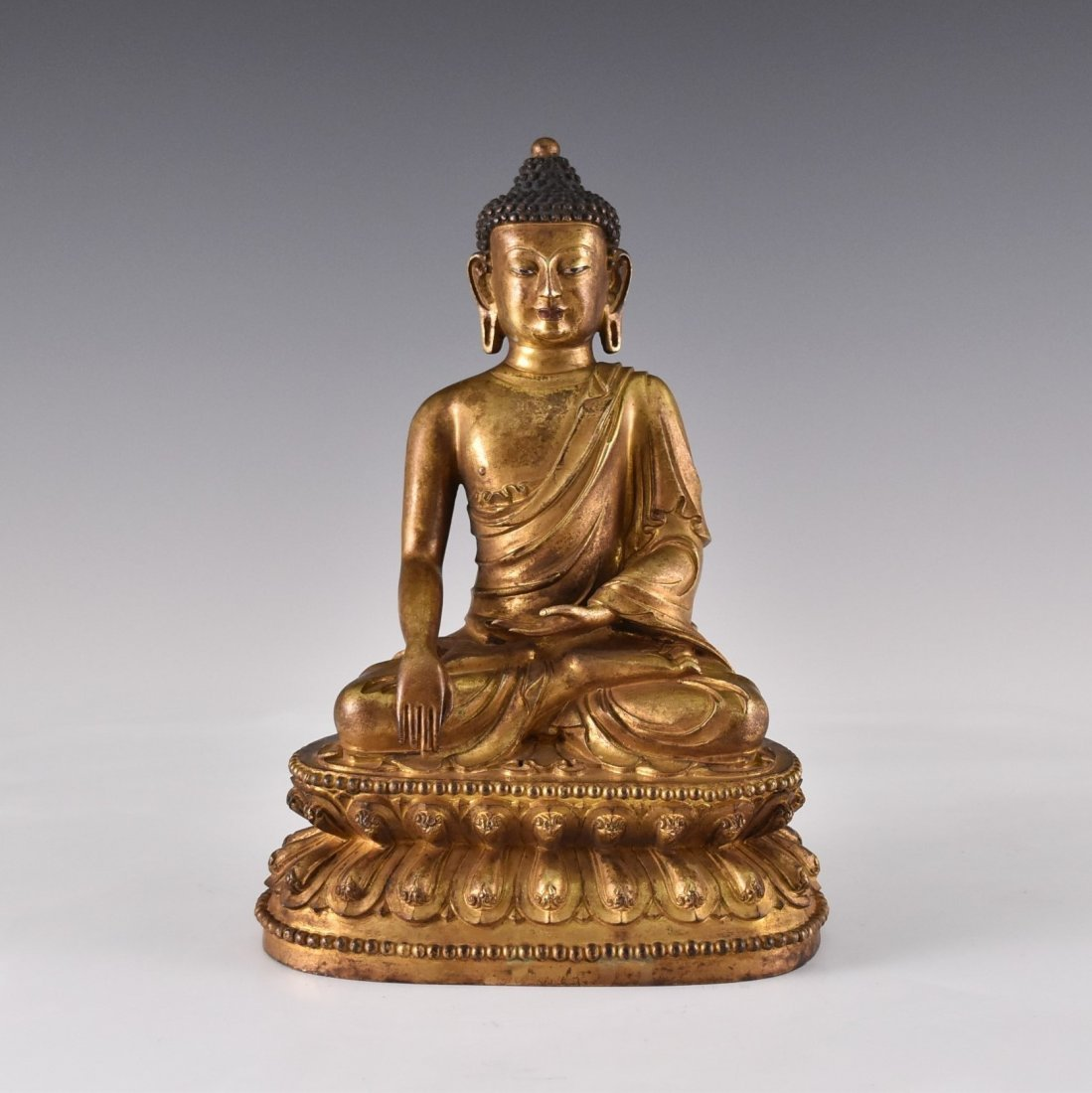 YONGLE MARK, GILT BRONZE FIGURE OF SAKYAMUNI BUDDHA