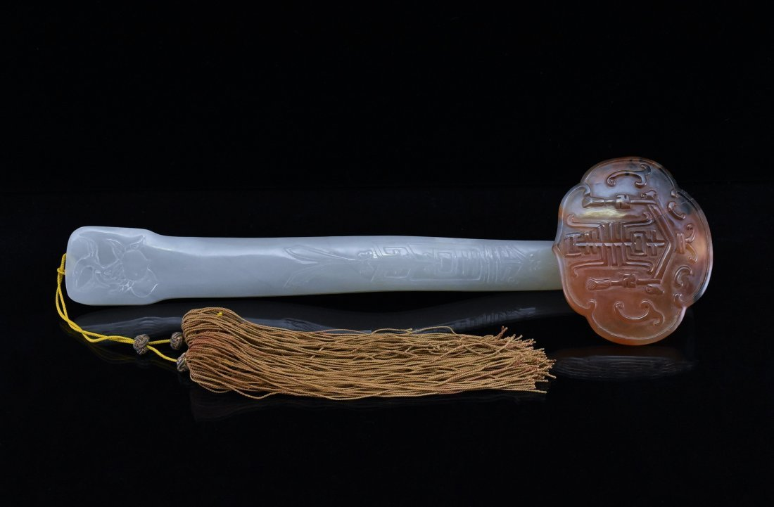 WHITE JADE RUYI SCEPTRE WITH NATURAL REDDISH INCLUSION