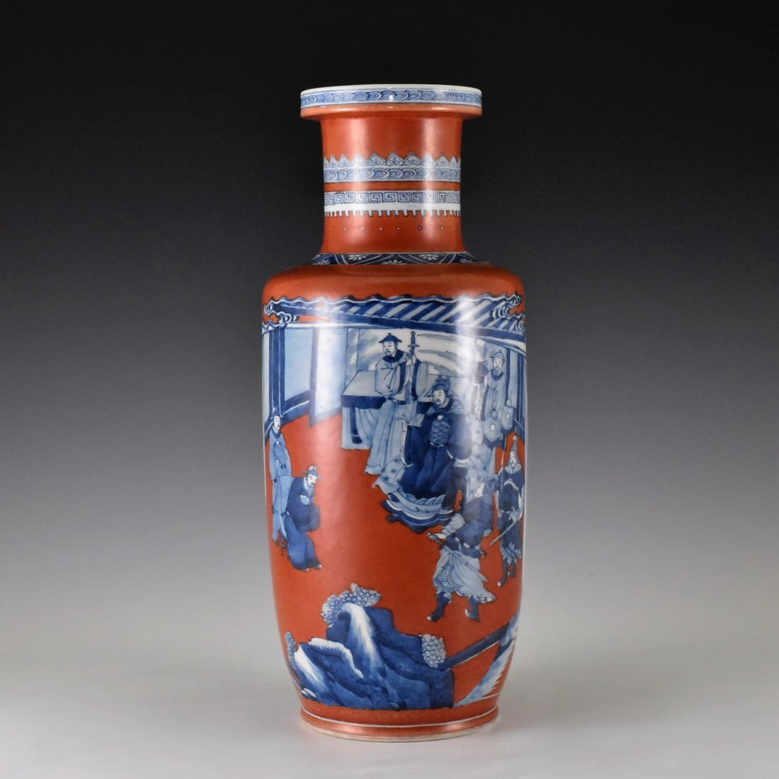 KANGXI BLUE AND WHITE IN RED GROUND ROULEAU VASE