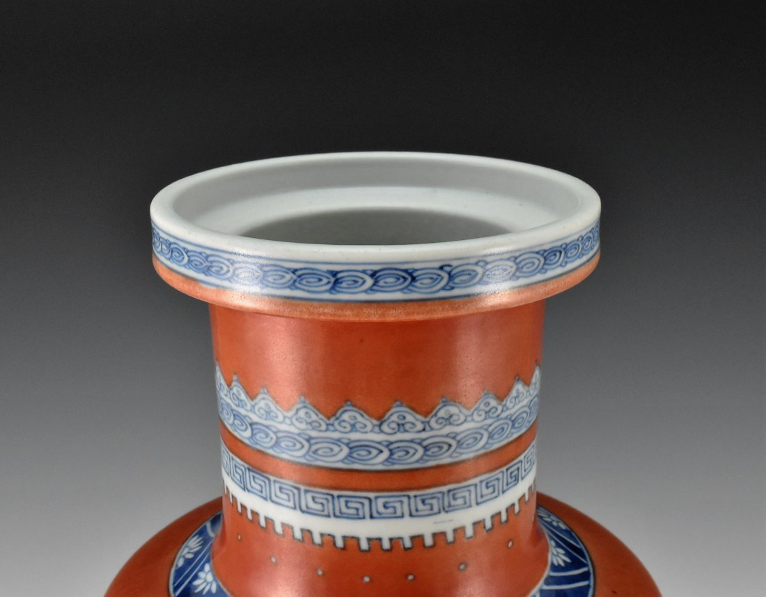 KANGXI BLUE AND WHITE IN RED GROUND ROULEAU VASE - 3