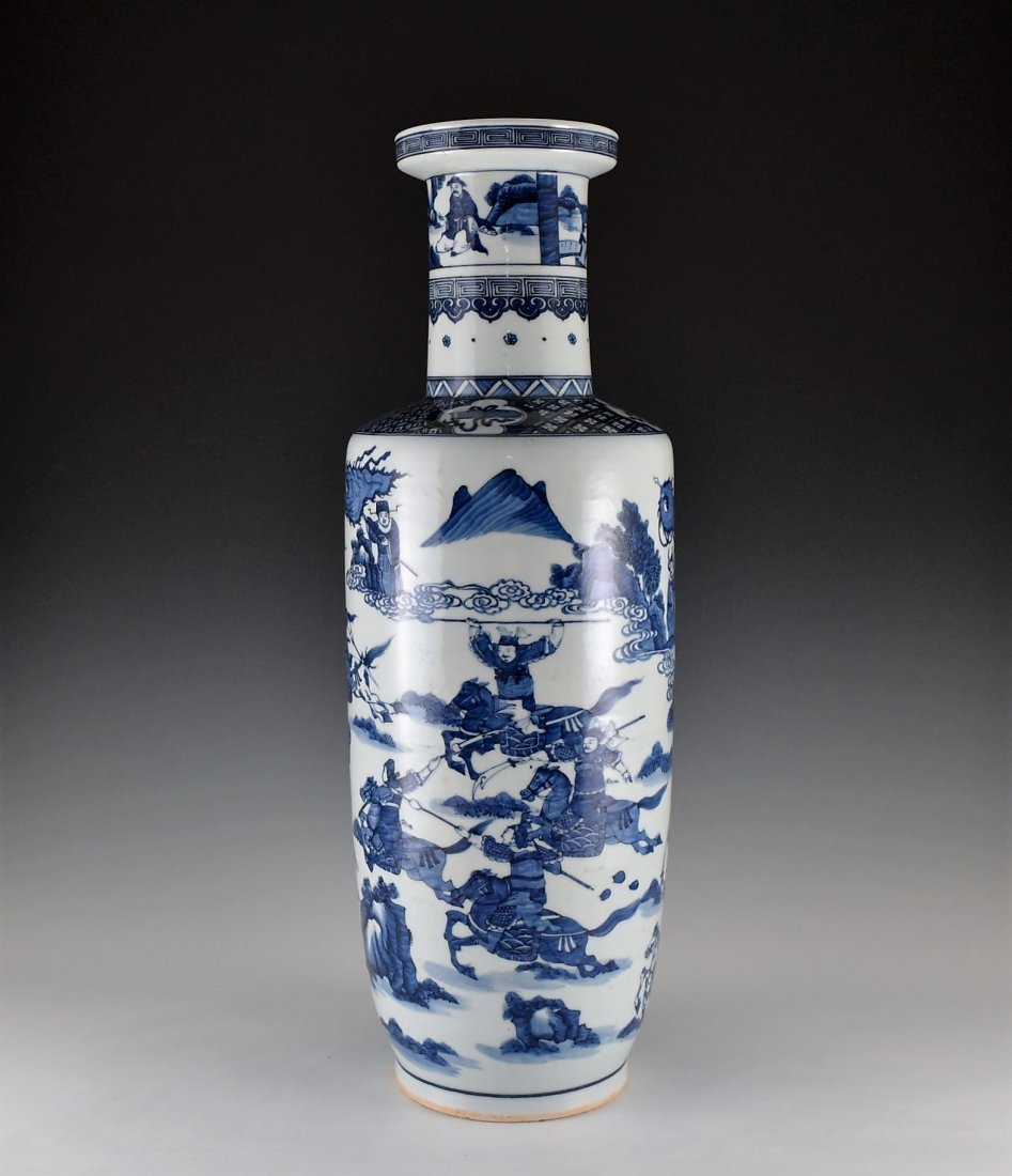 BATTLE SCENE BLUE AND WHITE ROULEAU VASE ON STANDS